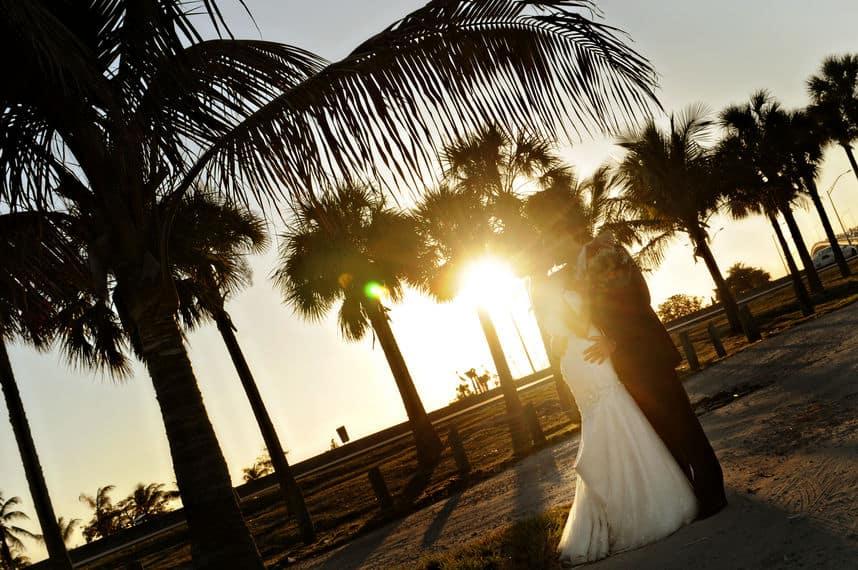 Sunrise wedding kiss