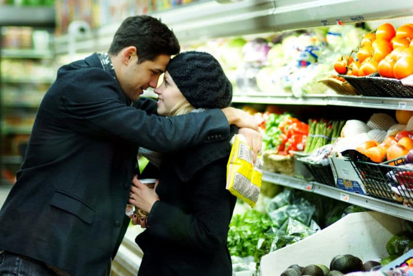 Engagement moments at a grocery store aisle