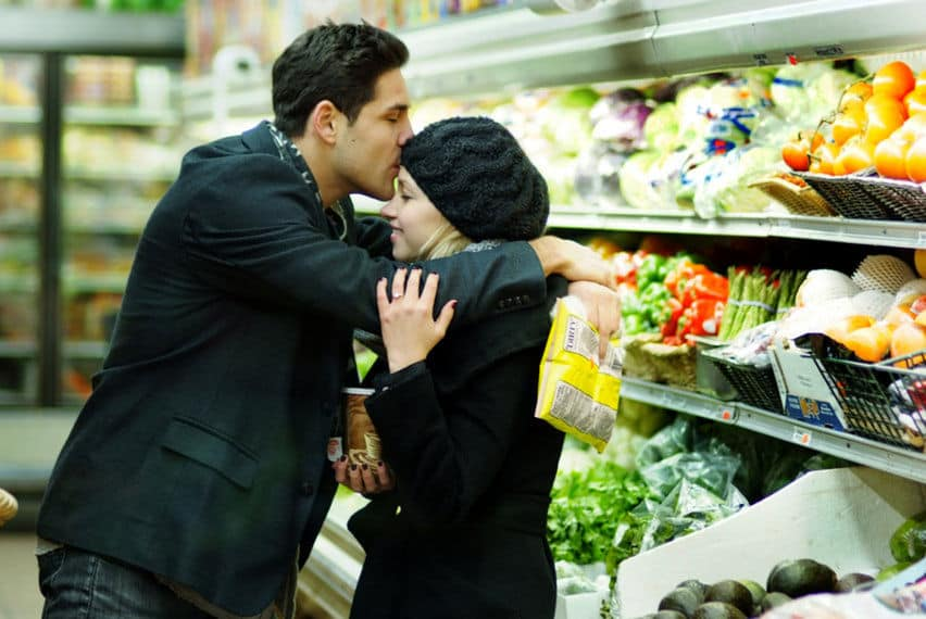 In engagement photos in the Grocery