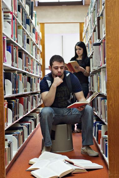 Engagement photos in the library and cool wedding ideas