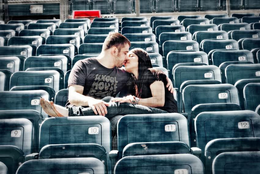 Engagement photos on the football stadium